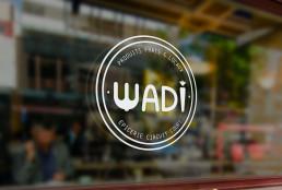 sticker vitrine Wadi Logo identité visuelle boutique